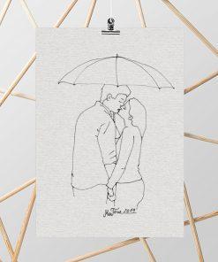 obraz całująca się para pod parasolem