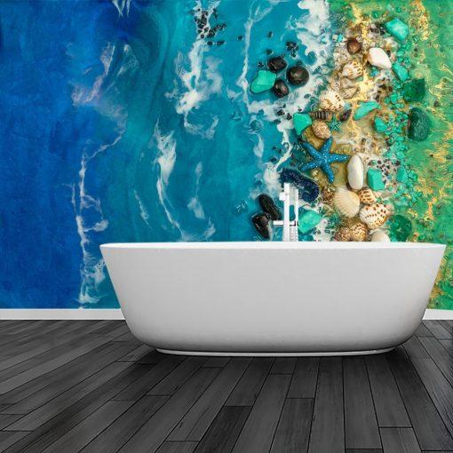 Fototapeta turkusowe morze z kamieniami inspiracja do łazienki