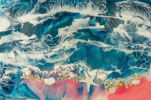 fototapeta dekoracja z kamieniami i muszelkami niebiesko różowa