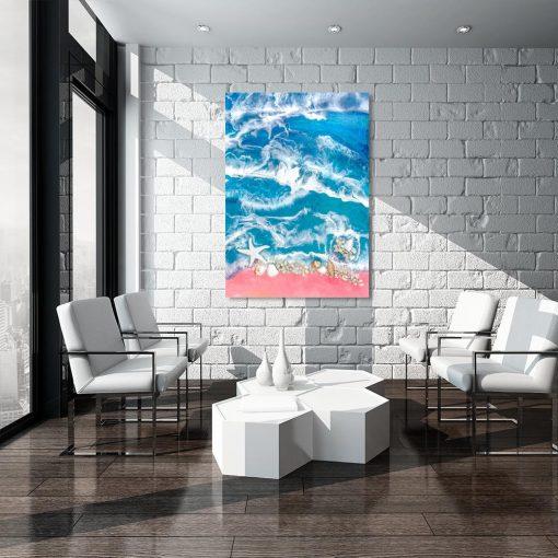 obraz morze w różowo niebieskich barwach z kamykami